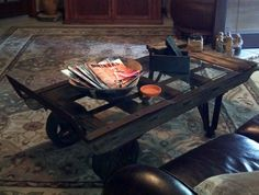 Old dolly found in my Dad's basement that I turned into a fabulous rustic coffee table....  love it!