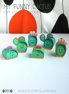 Print & create 6 cactus favor boxes and there editable tags.  Come closer and dont worry you wont get stung ! These little cactus fellows are real nice !  They will make funny favors for a party: Fill them with candies, chocolates or small gifts and edit your own text on the tag (in acrobat reader) to make extra special gift.  The cactus gift box come in 3 different shapes. Each box is unique with a different color, flower, spines & pot color. ---* MESURMENTS*--- Cactus shape 1: ≈L 2...