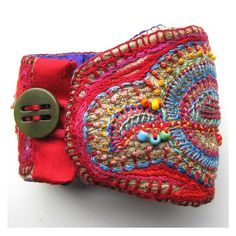 Impress your friends and feel swanky with this  organically shaped one of a kind cuff. Pretty gorgeous  is what some are saying.    This cuff would be wonderful to dress up or for casual wear.    8.5 inches long and 3.3 inches at the widest point.  Embroidered on a scrap of upholstery fabric.