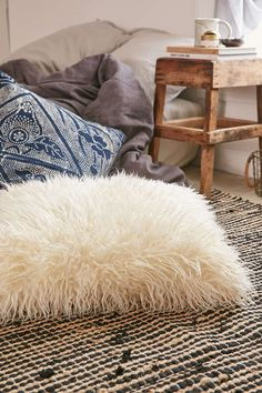 This Mongolian faux fur pillow—$14.99   19 Insanely Cozy Accessories That Will Make You Never Want To Leave Your Bed