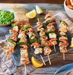 These fragrant fish skewers are hard to beat. Marinated in lemon juice, garlic and green herbs, these succulent cod, salmon and king prawn kebabs taste incredible served straight off the grill.