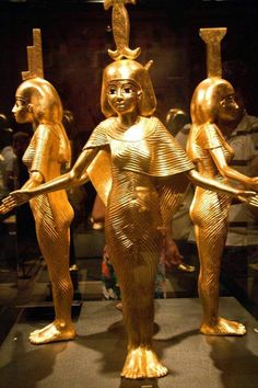 Three of the 4 protective divinities which surrounded the canopic shrine of Tutahknamun.