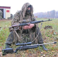 Russian sniper whith 7,62 Dragunov sniper rifle in his hands and Sako TRG-42 at his legs.