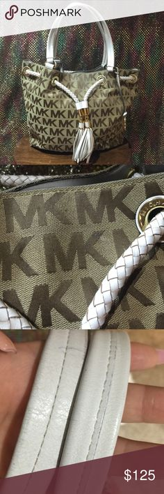 """Michael Kors """"drawstring"""" purse 100% authentic. Khaki/ light brown color. Medium sized MK purse w/ braided tassels in front & signature goldstone hardware enhance an easy gathered tote w/ modern Michael Kors logo print. Magnetic snap closure. Interior zip, wall & phone pockets. Outside material is in really good condition. As seen in pics, white material shows a little wear up close. Michael Kors Bags Totes"""