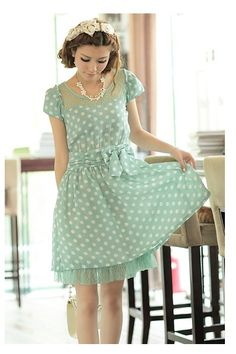 innocent and feminine, I love this mint-green polka dot dress with the tulle! The pearls are so fitting!