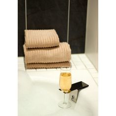 Bosign's Suction Cup Wine Glass Holder is a wonderful accessory for the bathtub. Made of polished stainless steel it has been designed so that it easily fastens to the side of the bathtub thanks to a strong suction cup. No need to worry about knocking your glass off the edge of the bathtub, simply lie back, relax and enjoy!