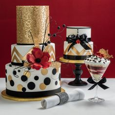 """For brides in love with glamorous, contemporary cakes, the glittering gold of our modern Bold Metallic designs are sure to put a gleam in their eyes. Main cake as shown: 10"""" (Tall Tier) X 8"""" X 6"""" (Tall Tier) round layers. Serves 96 (including top tier). White Corrugated Cake Board 6"""" Round - Waxed   White Corrugated Cake Board 8"""" Round - Waxed   Chevron Impression Mat   Fabric Textures Impression Mat   SILICONE STENCIL-ROUND CUTTERS & MOLDS   Foil Cake Drum 12"""" Round - Gold   Delivery ..."""