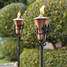 Pairing durable metal construction with French-inspired artistry, the Fleur-de-lis Torch enhances outdoor living spaces with the soft glow of flames.