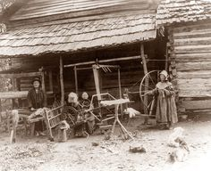 Tennessee Mountain Family in front of their log cabin. Talk about self reliant folks, they have two spinning wheels and all sorts of other things to allow them to provide for themselves.