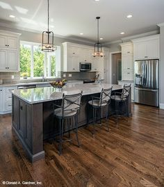 This kitchen island offers seating for casual meals. The Butler Ridge house plan 1320-D. #WeDesignDreams