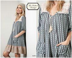 Tunic Dress with lace/ crochet detail at neckline. www.theballardboutique.com