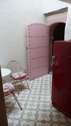 could do this in the second door as you walk into laundry space...exquisite tiles, pink door!!