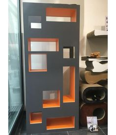 The Reading Cat is a piece of climb and scratch furniture with the allure of a bookcase and room divider. Furniture Scratches, Cat Furniture, Cat Gym, Showroom, Bookcase, Cat Trees, Shelves, House, Cat Things