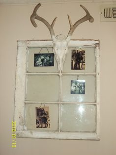Antlers on a old window with black and white family photos
