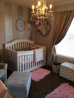 Beautiful baby girl nursery... Love the entire room and especially the thick silver striped accent wall! Always wanted to try that in a bedroom but looks fabulous in this nursery too!