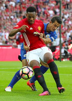 Manchester United's Anthony Martial and Leicester City's Luis Hernandez in action during todays match during the FA Community shield match between...