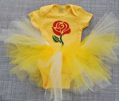 This listing is for one set that includes a Belle tutu and matching onesie. Perfect for your little princess to wear on your Disney trip or just around the house! The onesie is hand dyed golden yellow and has a felt rose applique ironed on the the front. Tutu is made with yellow, pale yellow, and cream tulle tied around elastic that is sewn together for extra durability. Tutu sizes are based on average waist size and length (refer to sizing chart photo). Elastic is measured unstretched…