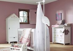 Cute Baby Girls Room Pictures Collection 2014 : Attractive Mauve Baby Girls Room Design Inspiration with White Baby Crib and Wooden Floor also White Drawer Storage
