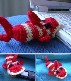 Fish USB cozy crochet pattern on Ravelry.  Adapt this to MochiMochi's baby alligators.