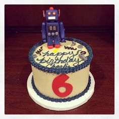 A very special robot birthday cake for a very special birthday boy! Sfcs's very first dairy free cake! Chocolate cake, strawberry filling vanilla icing. We hope Charlie enjoys his birthday cake! Photo by Sugar Flower Cake Shop. www.sugarflowercakeshop.com