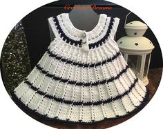 Baby Dress Crochet, Flower Girl Outfit, Crochet Dress for Girls, Baby Crochet Hat, Baptism Dress, Christening Outfit, Champagne Dress  Whether its a wedding or a baptism, this baby dress crochet is here to make your girl look beautiful. When youre planning a special occasion and need your little princess to look her best, its important to choose dresses that will compliment her natural style.  Model name: EMMA  Details: - UNIQUE handmade set (dress, hat) - Size: 12-24 months - Heads…