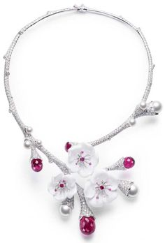 Limelight Garden Party necklace by Piaget. 18-carat white gold necklace set with 929 brilliant-cut diamonds, 9 round-cut pink sapphires, 3 briolette-cut tourmalines, 3 round-cut pink tourmalines, 1 oval-cut pink tourmaline, 3 carved white chalcedony and 9 pearls. Via CIJ Jewellery Magazine.