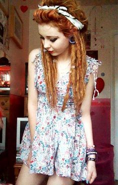 Pin-up hair and dreads: a really fascinating and unique idea. I'm liking it. :-)