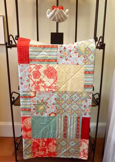 Baby Quilt - Modern Patchwork in Aqua, Red, Blue and Cream via Etsy.