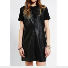 Lucca Couture Vegan Leather T-Shirt Dress Looks awesome paired with your favorite Doc Martens. NWOT. Size small but fits medium. Listed as Urban Outfitters because I bought it there. Urban Outfitters Dresses