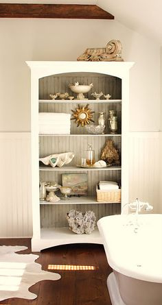 (I have a bookcase like this...need to move, paint & decorate!)   Love the gray back in this bookcase.