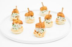 House-made bite-size waffles with a crispy fried chicken drumette and creamy chicken-chive gravy, by Occasions Caters in Washington, D.C.  Photo: Tony Brown/imijphoto.com for BizBash