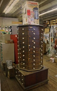 """This octagonal """"nail"""" cabinet is still in use at a Hardware store in New Braunsfels, Texas.  Wouldn't it make a great artsy-bits storage cabinet?"""