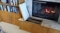 The raised fireplace hearth is nice place to sit and allows building a cabinet below to store the wood. The hinged doors use gas filled struts to aid in gently lifting/lowering the seats/doors which are covered in marble. I found the gas lifts on eBay for a fraction of the retail price and attached then with modified Stanley angle brackets.
