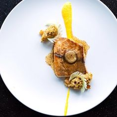 """Seared Barramundi with Jean-Yves bordier vanilla butter, carrot ginger purée, quenelles of brown rice, caramelized parsnips, and celery """"eyelashes"""" by @lennardy #TheArtOfPlating"""