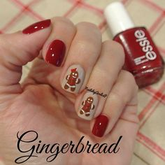 Today's mani is inspired by the famous Christmas cookies... Gingerbread. Used Essie's Sand Tropez & Twin Sweater Set. Hand painted gingerbread boy & girl with painted red studs. Instagram media by nailsbyarelisp.