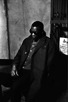 This photo of Ray Charles by Jim Marshall is a classic. Not use to seeing Ray like that away from a piano and not performing....interesting.