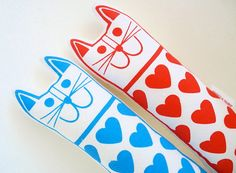 These fun love heat cats were designed by Jane in her studio. She designed them for her daughter. Each has been professionally screen printed here in