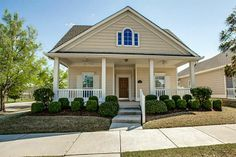 This is adorable! Love the front porch!