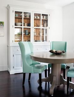 Back of hutch and turquoise chairs