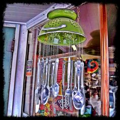 Collander/flatware wind chimes. Use up all the odd pieces of flatware I have laying around.