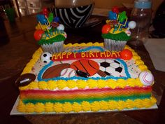 Sports birthday cake for two brothers.  They each get their own big cupcake
