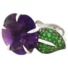 Chanel Amethyst  Tsavorite Garnet Flower Ring | From a unique collection of vintage fashion rings at https://www.1stdibs.com/jewelry/rings/fashion-rings/