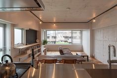 Z l construction singapore to achieve raw industrial look exposed black round conduits White walls and exposed brick go minimalist in this couple s retreat