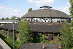 Roundhouse in Berlin-Pankow / A roundhouse is a building used by railroads for servicing locomotives. Roundhouses are large, circular or semicircular structures that were traditionally located surrounding or adjacent to turntables.