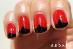 Turn your head just slightly... see the hearts? After you've mastered the traditional French manicure, swap in red and black polish, and add a little triangle for your own vampy version.