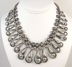 """Spectacular Frank Patania Vintage Handmade Thunderbird Shop Sterling Silver Necklace - necklace measures 17"""" long and weighs a substantial 101.5 g. The pendants graduate in size towards the bottom. They range in size from 1/18"""" long and 7/16"""" wide to 1 7/8"""" long and 3/4"""" wide. Sold on June 22, 2014 on eBay for $3249.44."""