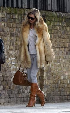 Kate Moss in vintage 70s fur jacket, skinny jeans and knee high boots