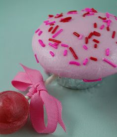 Pink color icing with pink color sprinkles . Perfect Cupcake idea for a Baby Shower!