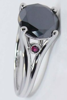 Gorgeous, perfect round cut black diamond with stunning little rubies...