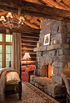 take me there....master bedroom in the log home